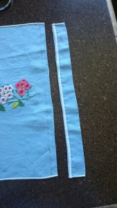 Blue Floral Apron Dress, trim bottom of towel