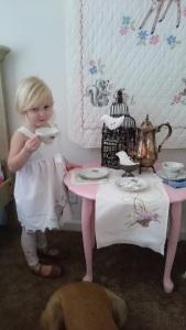 Pretend tea party, scrunchie face