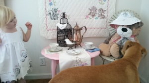 Pretend tea party, sophie and doggie